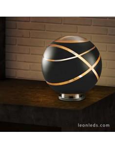 Lámpara para sobremesa Serie Faro de Trio Lighting de color Negro Oro y Cromo con base redonda | LeonLeds Iluminación